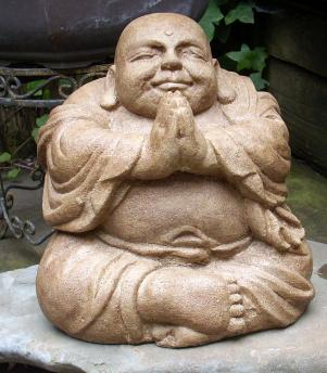 A statue of a fat buddha praying
