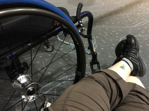 Sitting on the floor at the Denver International Airport next to my wheelchair